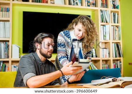 two students study in library - stock photo