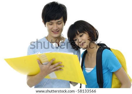 Two students with books and backpacks - stock photo