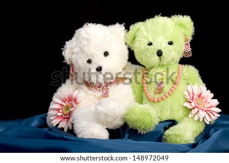 Two stuffed animals decked out in jewelry and flowers  Concept - BFF - Best Friends forever - stock photo