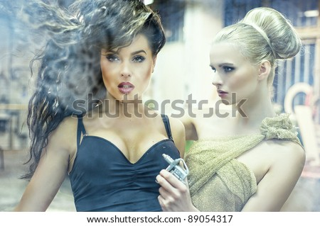 Two stunning ladies in an old factory - stock photo