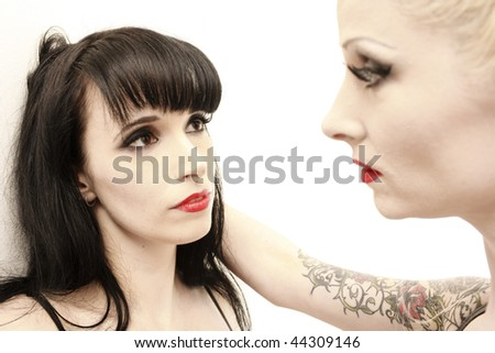 two stunning woman posing together. - stock photo