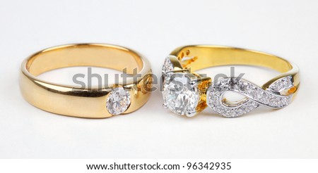 Two style of golden rings with diamond isolated on white.