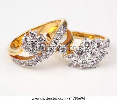 Two style of golden rings with diamond isolated on white background. - stock photo