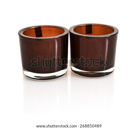 Two stylish ceramic candlesticks with reflection on the white background. - stock photo