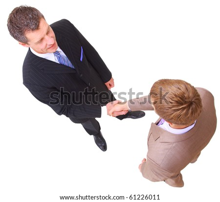 two successful business men shaking hands - stock photo