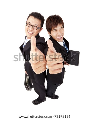 Two successful  businessman with thumb up - stock photo