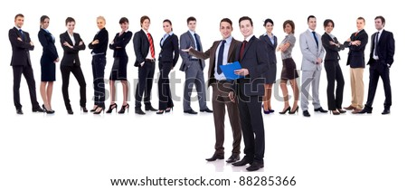 two successful leaders welcoming to their team or presenting it - stock photo