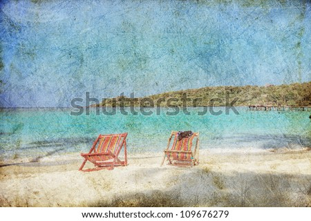 Two sun beach chairs on shore near sea in grunge and retro style - stock photo