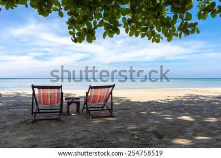 Two sun chairs on the beach of Thailand