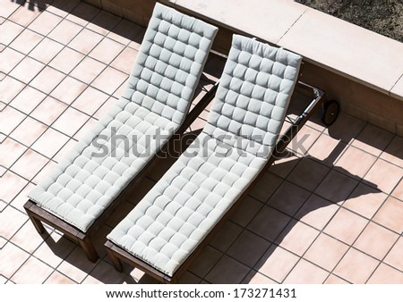 two sunbeds on a sunny day - stock photo