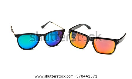 Two sunglasses, blue and yellow lens. Isolate on white. - stock photo
