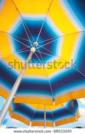 Two sunshades in a bright sunny day - stock photo