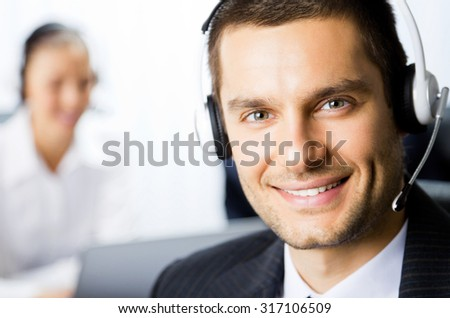 Two support phone operators at workplace - stock photo