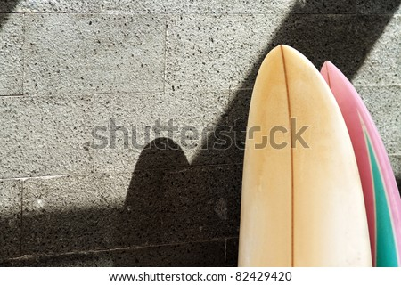 two surfboard standing on empty wall - stock photo