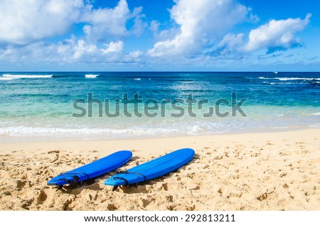 Two Surfboards on the sandy Poipu beach in Hawaii, Kauai - stock photo