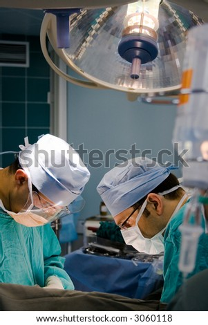 two surgeons at the time of operation