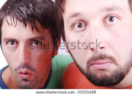 Two surprised man with interesting excited faces - stock photo