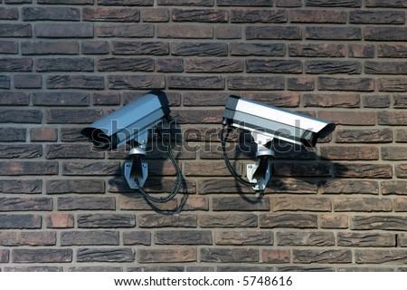 Two surveillance cameras - stock photo