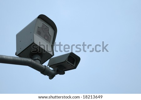 Two surveillance cameras mounted on the pole to see traffic - stock photo