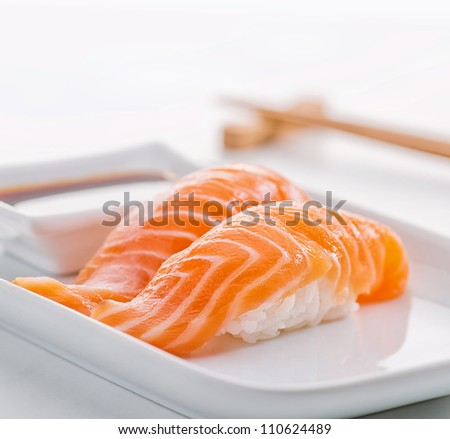 Two Sushi Rolls Served On White Plate - stock photo