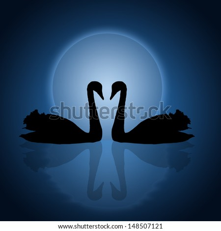 Two swans under the blue sunset - stock photo