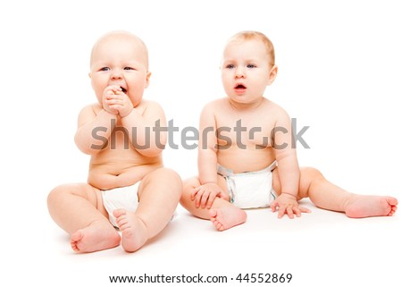 Two sweet babies in diapers, over white - stock photo