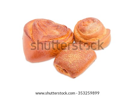 Two sweet buns different shapes, sprinkled with sugar and one bun with jam on a light background