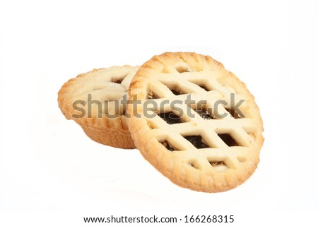 Two Sweet Christmas mince pies isolated on a white background - stock photo