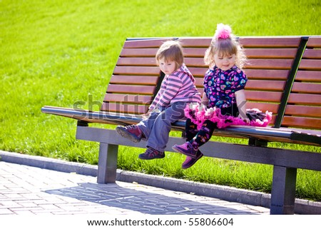 Two sweet friends sitting  on the bench