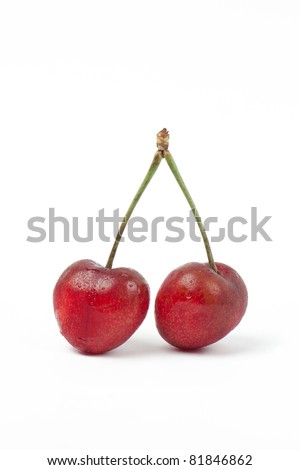 Two sweet red cherries isolated on white background - stock photo