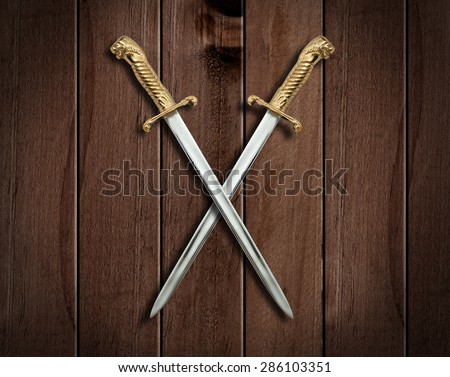 Two Swords on an old wooden Wall.