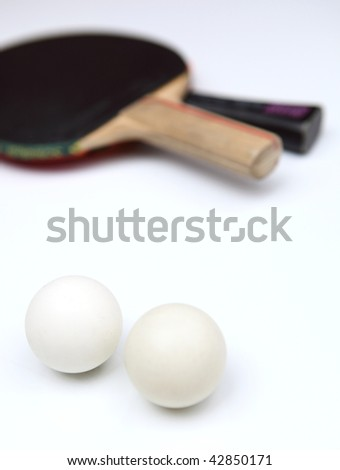 Two table tennis rackets and balls on white background - stock photo