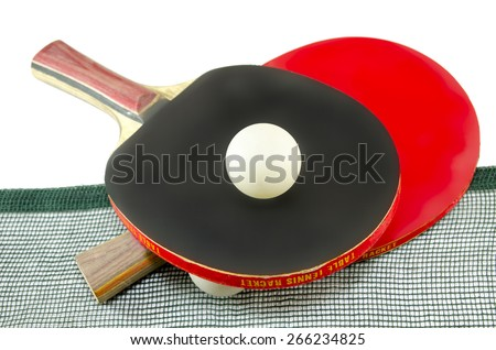 Two table tennis rackets one on top of the other and an old net isolated on white. One paddle is red and the other is black - stock photo