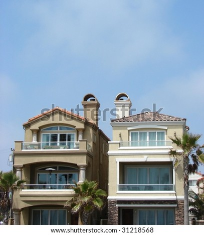 Two Tan beach homes - stock photo