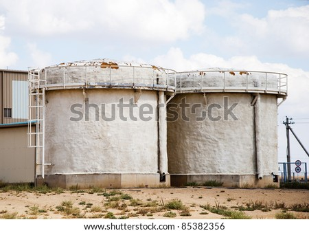two tanks for water on industrial site - stock photo