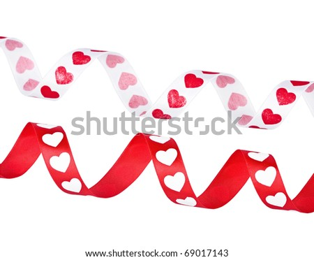 Two tapes with the hearts, twisted on the white - stock photo