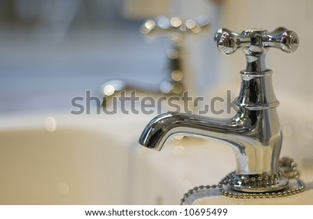Two Taps with close ups. Focus on first. - stock photo