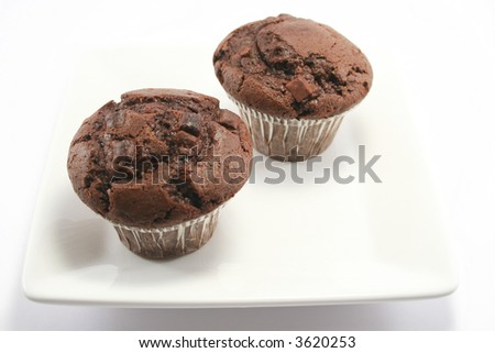 two tasty choc chip and choc sponge muffins - Double Choc heaven! - stock photo