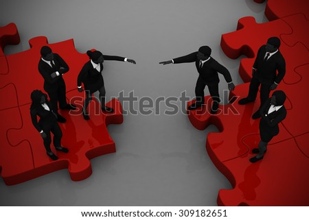 Two teams Merging on a jigsaw puzzle. Two teams of executives merging on a jigsaw puzzle showing a partnership and collaboration. - stock photo