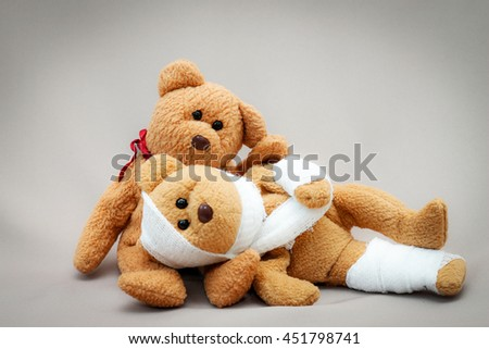 Two teddy bear with bandage on gray background,couples love be care when sickness,health care concept. - stock photo