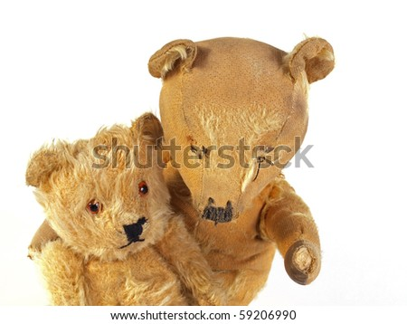 Two 1950 teddy bears having a cuddle.. - stock photo