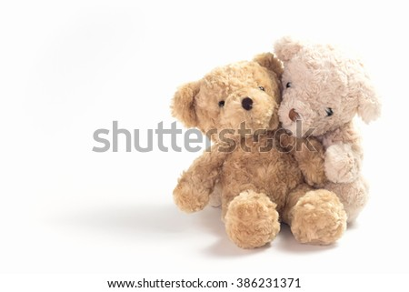 Two teddy bears hugging on white background. - stock photo