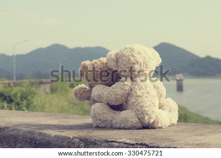 Two teddy bears hugging picnic. vintage style. - stock photo