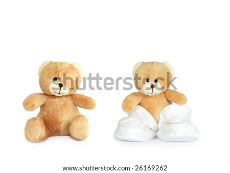 Two teddy bears, one with a plaster over an eye, the other wearing baby booties, over white background. - stock photo