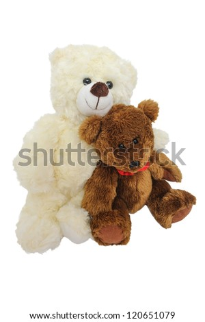 Two teddy bears sitting close to each other hugging on white isolated background - stock photo