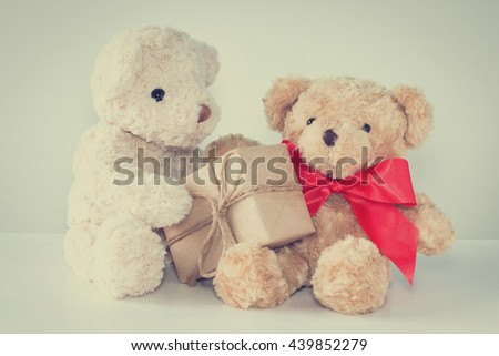 Two teddy bears with gift. vintage style.