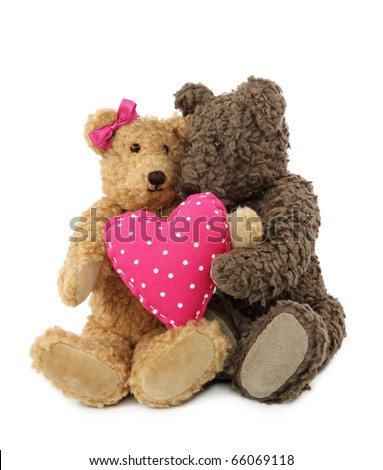 Two teddy bears with pink heart isolated on white background - stock photo