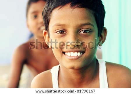 Two teen boys looking at the camera. - stock photo