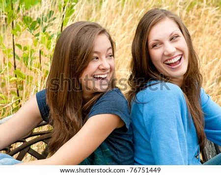 Two Teen Girl Friends Laughing - stock photo