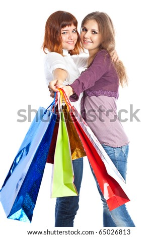 Two teen girls with bags. Isolated on white background - stock photo